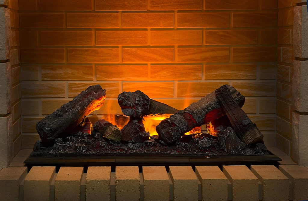 burning firewood in brick fireplace