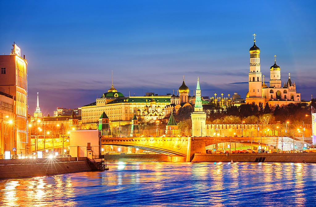 Moscow Kremlin glowing in the evening light over Moskva River, R
