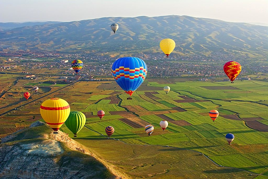 Cappadocia. Colorful hot air balloons flying over the valley at